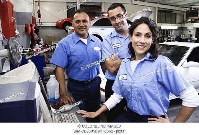 Group of auto mechanics in auto repair shop