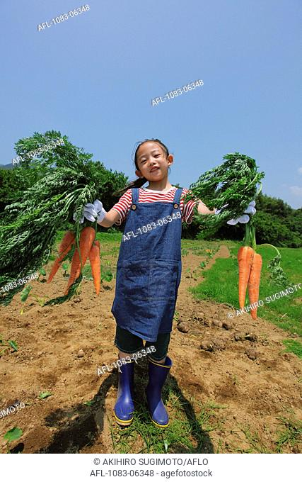 Girl With Bunch Of Carrot