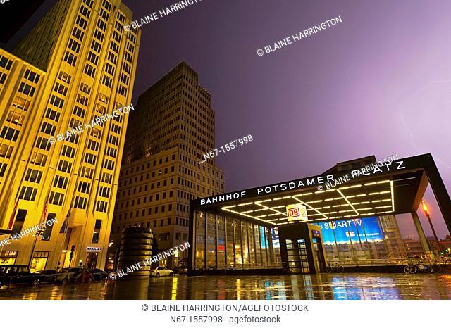 Lightning over the Bahnhof Potsdamer Platz and the Ritz-Carlton Hotel on left, Mitte, Berlin, Germany