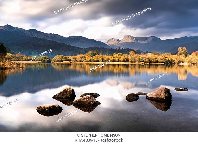 The Langdale Pikes reflected in the tranquil River Brathay, autumn, Elterwater, Lake District National Park, UNESCO World Heritage Site, Cumbria, England