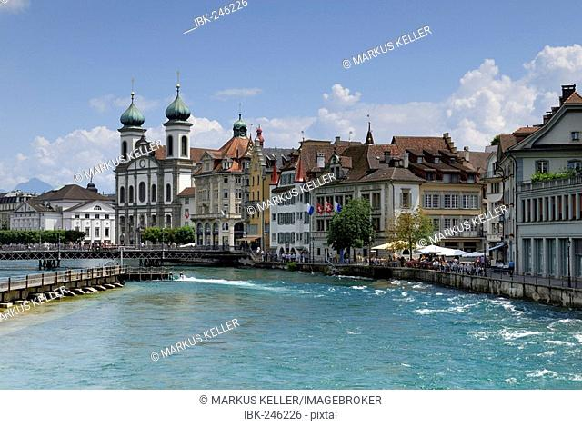 Lucerne - the reuss river and a church in the background - Switzerland, Europe