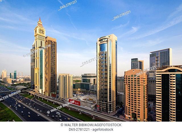 UAE, Dubai, Downtown Dubai, high rise buildings along Sheikh Zayed Road, elevated view, dusk