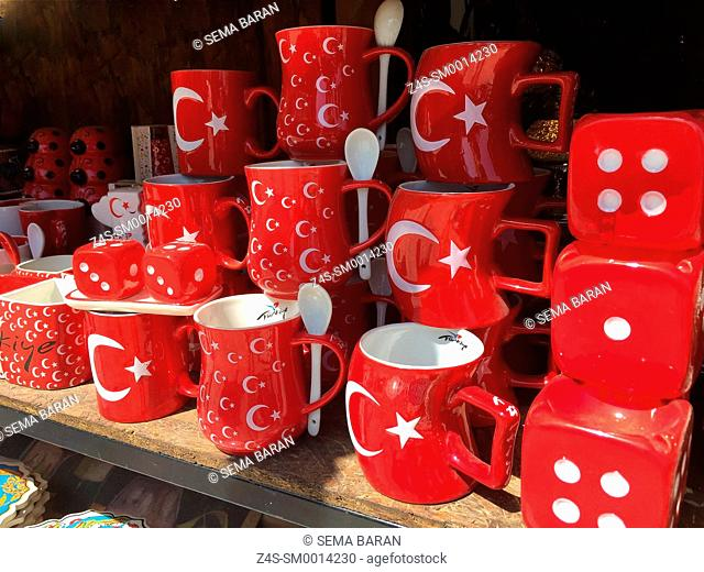 Turkish flag patterned red mugs and red dices on the rack of strret market at village Sirince, Selcuk, Izmir, Turkey, Europe