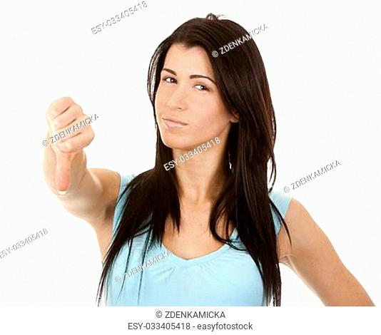 casual brunette showing thumb down gesture on white background