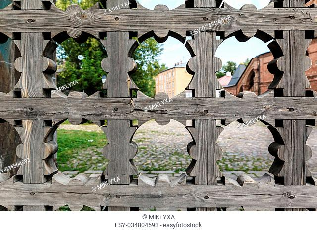old wooden lattice on the gates in a monastery Russia