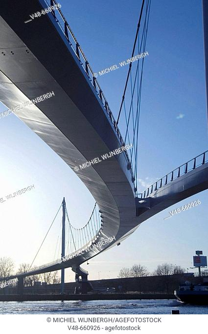Modern bridge for cyclist and pedestrians to a new built part of Amsterdam, Ijburg. Netherlands, (January 2007)