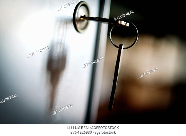 Backlight of a key in the lock of a door, Spotlight