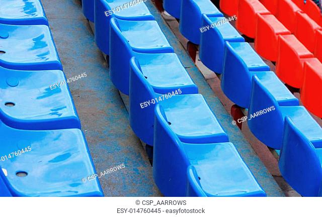 empty blue and red stadium seats