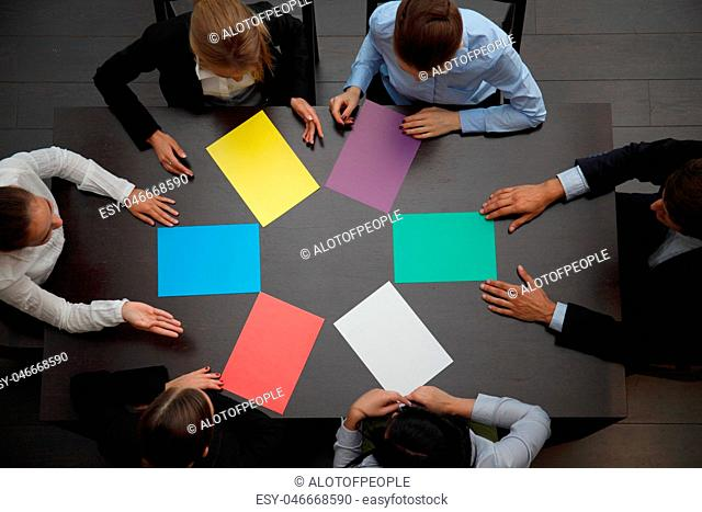 Business people and color paper