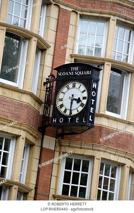 England, London, Chelsea, A clock and sign for the Sloane Square Hotel in Chelsea