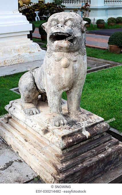 one of the two marble lions at the entrance of the temple