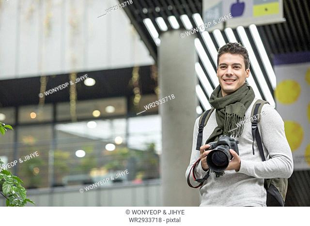 Young smiling male tourist