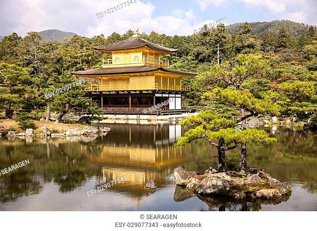 The Golden Pavilion, or Kinkaku, at the Rokuonji complex on the outskirts of Kyoto in Japan is covered in gold leaf. This is a World Heritage site