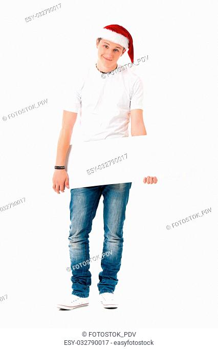 Caucasian man wearing christmas hat for santa. Teenager in white t-shirt with blank sign isolated on white background. Successful boy wearing Santa Claus hat -...