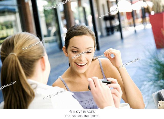 Woman showing her friend a picture on her camera