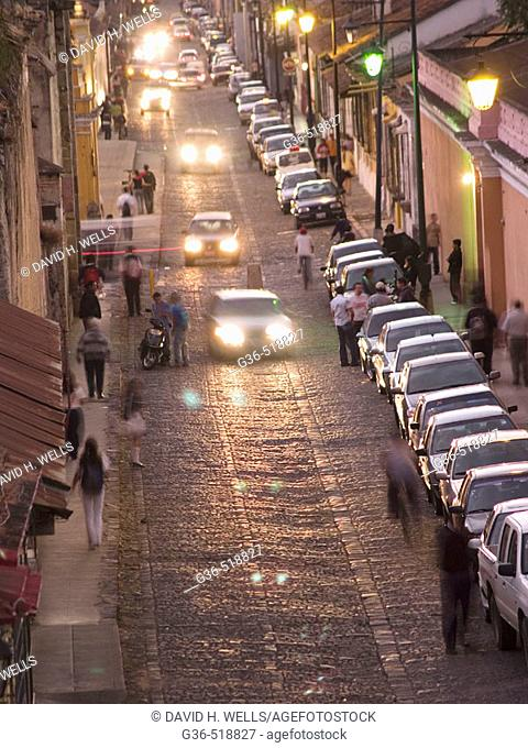 Traffic at twilight on the streets of Antigua, Guatemala