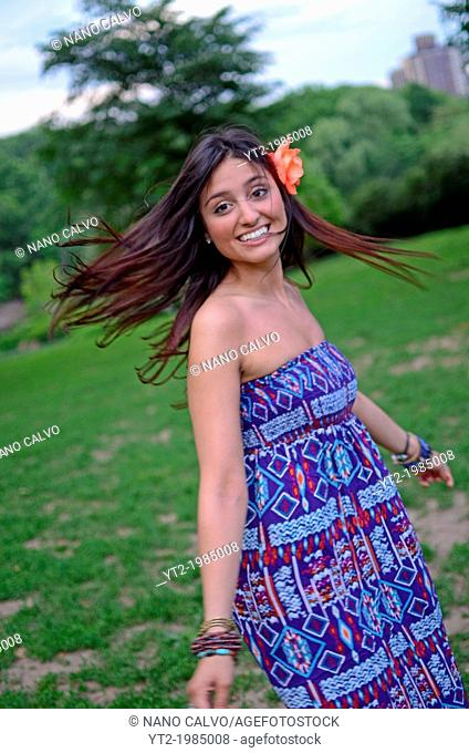 Attractive young mixed race woman in Central Park, New York City
