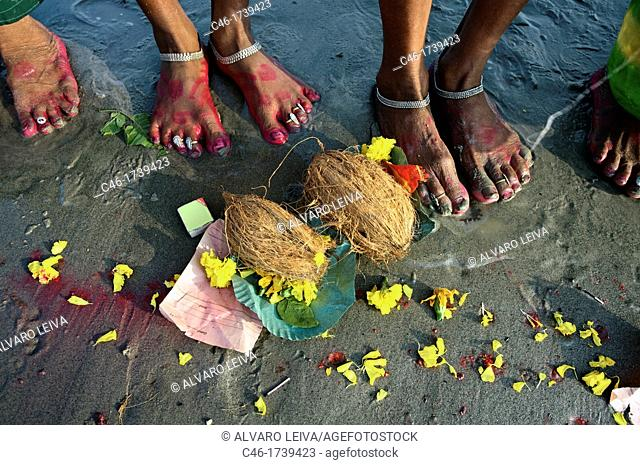 Pilgrims making offerings at the confluence of the river Ganges and the Bay of Bengal , Sagar Mela, India, Ganges River
