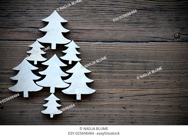 Christmas Trees On Brown Wooden Background With Copy Space For Your Text Here Or Free Text. Vintage Style And Frame. Close Up Or Macro View