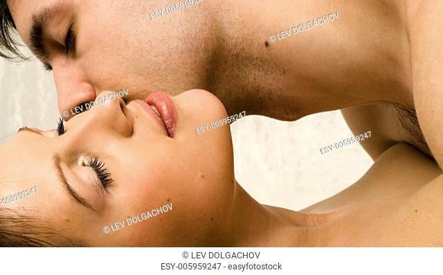 couple gently kissing