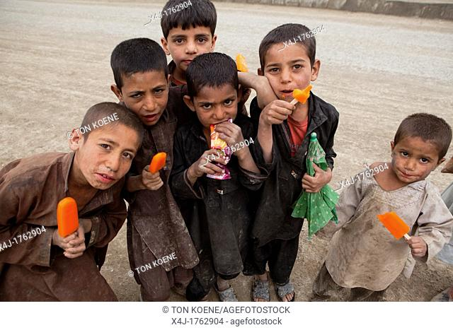 Afghan children at a icecream seller in kabul