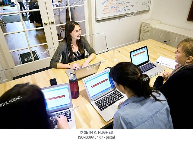 Female colleagues in a meeting with laptops