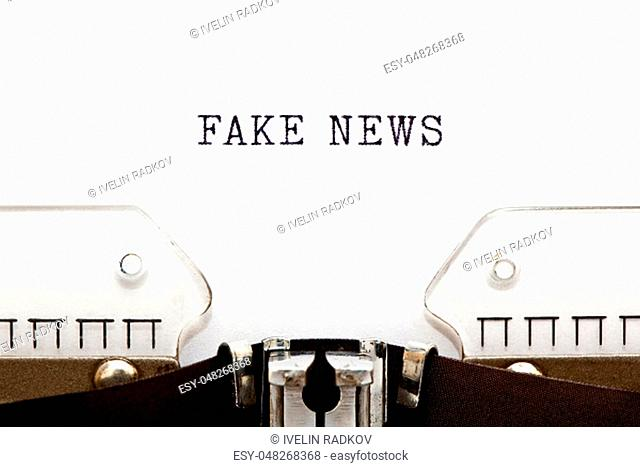 Text Fake News typed on vintage typewriter with copy space. Hoax news, false information or media propaganda concept
