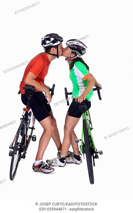 Couple with bike isolated on white,kiss each ather