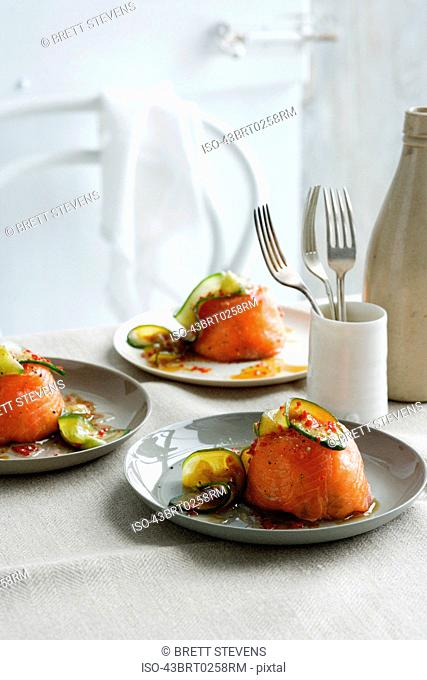 Plates of salmon timbales on table