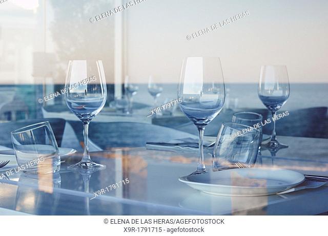Reflected sea on a restaurant's window  Denia  Alicante  Spain