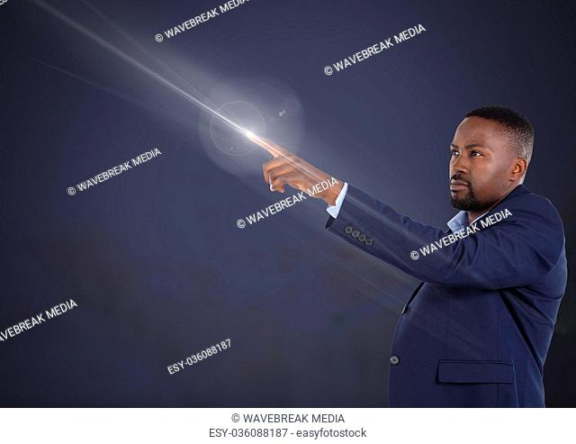 Businessman pointing with air light glow