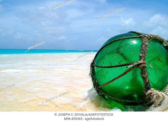 Glass fishing float on beach. Bikini Atoll. Marshall Islands