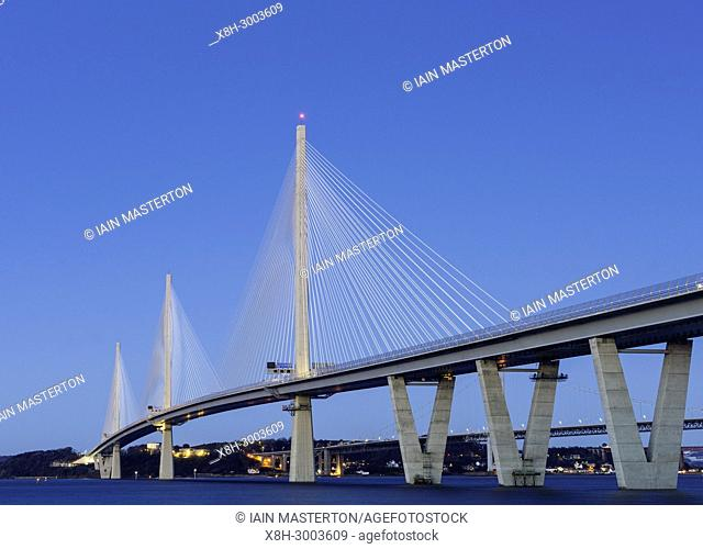 Dusk view of new Queensferry Crossing bridge spanning the River Forth at South Queensferry, Scotland, United Kingdom