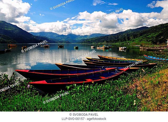 Wooden boats on the Phewa lake, Pokhara, Nepal
