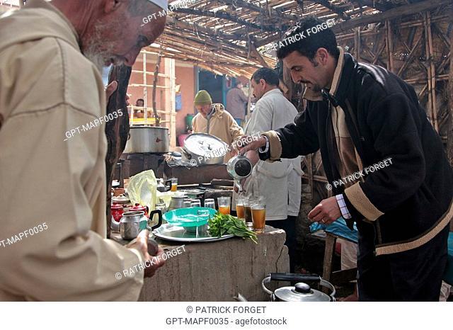 PREPARING MINT TEA IN THE BERBER MARKET OF TAHANAOUTE, AL HAOUZ, MOROCCO