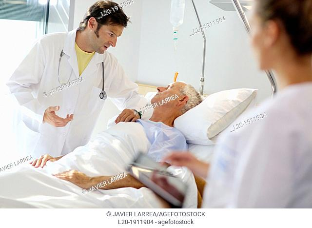 Doctor attending to patient in hospital room, Onkologikoa Hospital, Oncology Institute, Case Center for prevention, diagnosis and treatment of cancer, Donostia