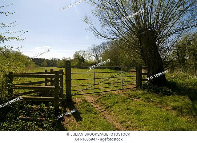 A kissing gate and farm track gate near the river cherwell, Oxfordshire