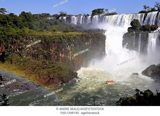 Macuco safari speed boat heading into Salto San Martin with rainbow, Iguassu falls, Iguazu national park, Argentina