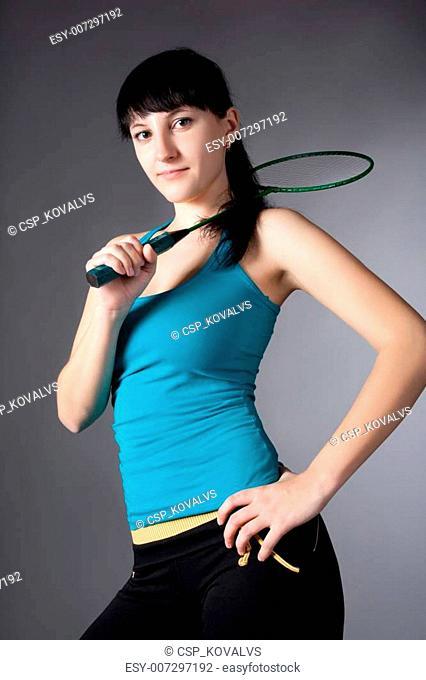 woman with badminton racket
