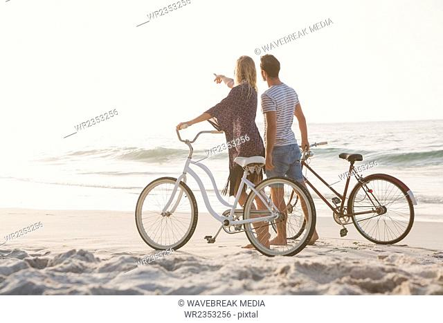 Cute couple walking next to bicycles
