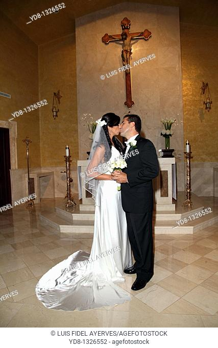 Just Married kissing in the Church