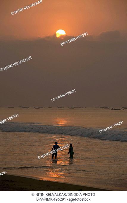 Couple bathing beach, puri, orissa, india, asia