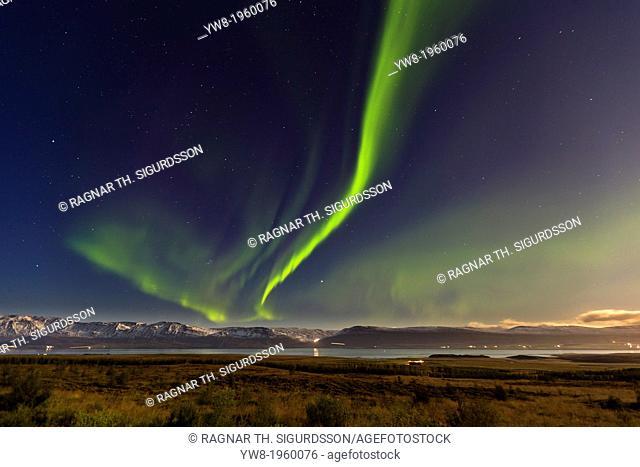 Aurora Borealis over farm in Eyjafjordur, Northern Iceland