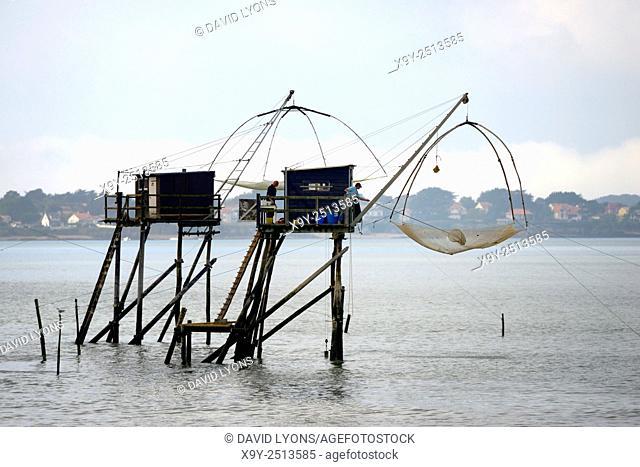 Traditional carrelet lift net fishing hut. Saint-Michel-Chef-Chef beach, Loire-Atlantique, France. Plaice smelt squid sole eel