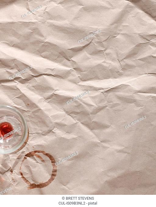 Wine stain on brown paper, overhead view