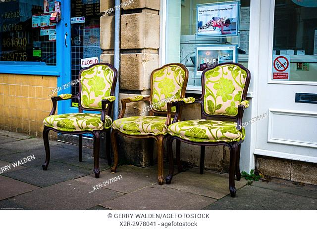 Ornate upholstered chairs at a street market in Bath, Somerset, England