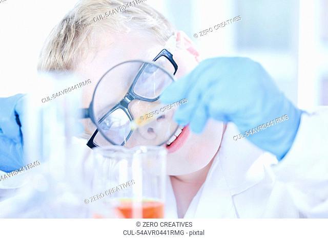 Boy playing scientist in lab