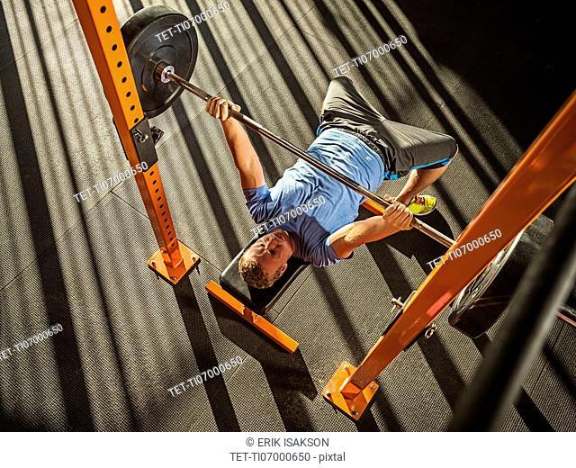 Young man bench pressing