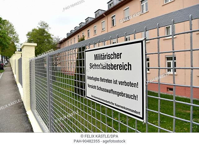 """A sign with the letters """"""""Military security premises. Unpermitted entrance is stricty forbidden!Attention Weapon usage!"""""""" can be seen at the fence of the..."""