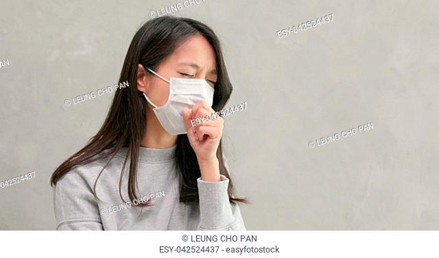 Woman wearing mask and feeling sick
